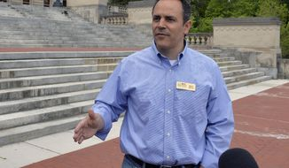 ** FILE ** In this May 16, 2014, photo Kentucky Republican senatorial candidate Matt Bevin speaks with reporters on the steps of the Kentucky State Capitol in Frankfort, Ky. (AP Photo/Timothy D. Easley)