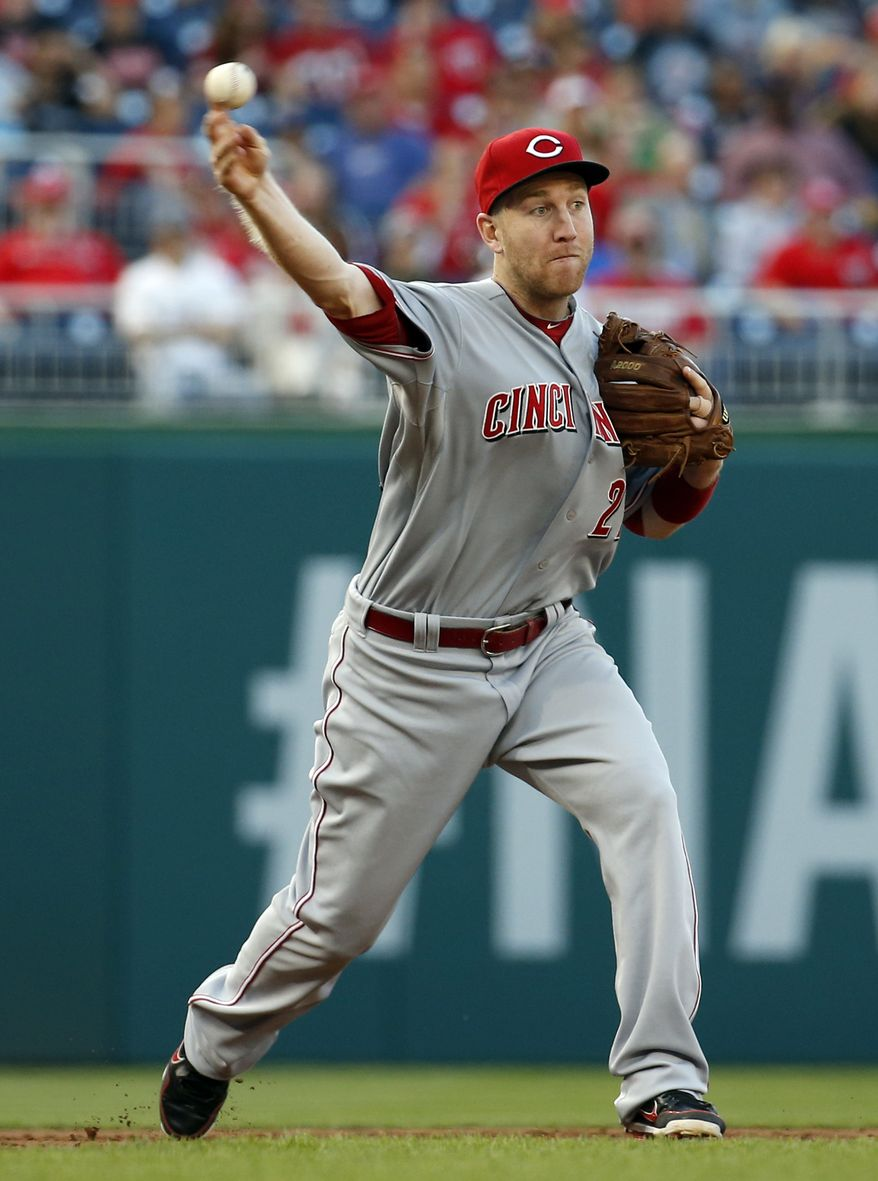 Cincinnati Reds third baseman Todd Frazier throws to first base for the out on Washington Nationals' Wilson Ramos during the first inning of a baseball game at Nationals Park Monday, May 19, 2014, in Washington. (AP Photo/Alex Brandon)