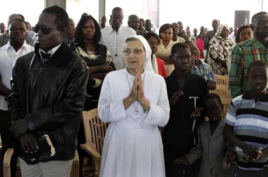 Christian worshipers pray during Christmas mass at a Church in Khartoum, Sudan, Wednesday, Dec. 25, 2013. (AP Photo/Abd Raouf)