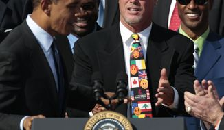 FILE - In this Oct. 7, 2011 file photo, President Barack Obama, left, looks towards quarterback Jim McMahon, wearing headband, as he honors the 1985 Super Bowl XX Champion Chicago Bears football team during a ceremony on the South Lawn of the White House in Washington. A group of retired NFL players says in a lawsuit that the league illegally supplied them with risky painkillers that numbed their injuries and led to medical complications. Attorney Steven Silverman says his firm filed the lawsuit Tuesday, May 20, 2014, in federal court in San Francisco. The eight named plaintiffs include Hall of Fame defensive end Richard Dent and quarterback Jim McMahon. (AP Photo/Pablo Martinez Monsivais, File)