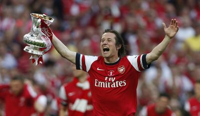 Arsenal's Tomas Rosicky celebrates with the trophy after their win against Hull City at the end of their English FA Cup final soccer match at Wembley Stadium in London, Saturday, May 17, 2014. (AP Photo/Sang Tan)