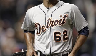 Detroit Tigers relief pitcher Al Alburquerque walks off the field after giving up a solo home run to Cleveland Indians' Michael Brantley in the tenth inning of a baseball game, Monday, May 19, 2014, in Cleveland. The Indians won 5-4 in ten innings. (AP Photo/Tony Dejak)