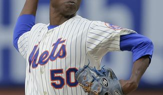 New York Mets starting pitcher Rafael Montero (50) delivers against the Los Angeles Dodgers during the first inning of a baseball game, Tuesday, May 20, 2014, in New York. (AP Photo/Julie Jacobson)
