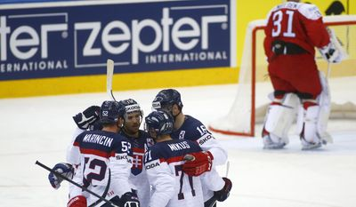 Slovakia players celebrate after Tomas Tatar scores against Denmark during the Group A preliminary round match at the Ice Hockey World Championship in Minsk, Belarus, Tuesday, May 20, 2014. (AP Photo/Sergei Grits)