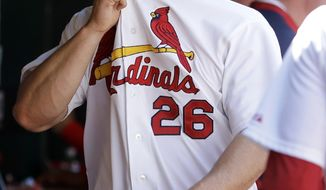 St. Louis Cardinals relief pitcher Trevor Rosenthal walks in the dugout after being pulled out of a baseball game against the Atlanta Braves during the ninth inning Sunday, May 18, 2014, in St. Louis. Rosenthal walked the Braves' Jordan Schafer with the bases loaded to score Freddie Freeman and the Braves went on to win 6-5. (AP Photo/Jeff Roberson)