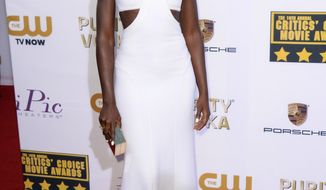 FILE - This Jan. 16, 2014 file photo shows actress Lupita Nyong'o in a white gown at the 19th annual Critics' Choice Movie Awards in Santa Monica, Calif. (Photo by Jordan Strauss/Invision/AP, FIle)