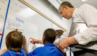 ** FILE ** U.S. Education Secretary Arne Duncan visits a classroom at Brick Church College Prep in Nashville, Tenn., on Tuesday, May 20, 2014. Duncan also spoke to an association of education writers and to teachers at Vanderbilt University. (AP Photo/Erik Schelzig)