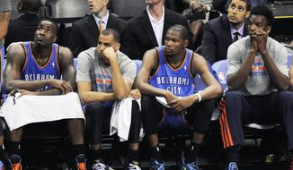 Players on the Oklahoma City Thunder bench sit during the final minutes of Game 1 of a Western Conference finals NBA basketball playoff series against the San Antonio Spurs, Monday, May 19, 2014, in San Antonio. San Antonio won 122-105. (AP Photo/Darren Abate)