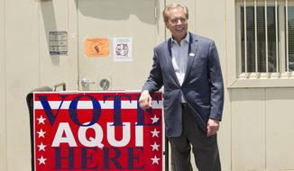 Lt. Gov. David Dewhurst smiles after voting in the runoff election for Lt. Governor in Austin, Texas, on Monday, May 19, 2014. (AP Photo/Austin American-Statesman, Jay Janner)