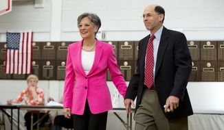 U.S. Rep. Allyson Schwartz, candidate for the Democratic gubernatorial nomination in Pennsylvania, accompanied by her husband, David, walks to the booth to vote Tuesday, May 20, 2014, in Jenkintown, Pa. (AP Photo/Matt Rourke)