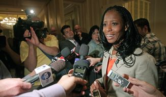 Republican Mia Love candidate for Utah's 4th Congressional District responds to questions from the media following the annual conference of the Utah Taxpayers Association Tuesday, May 20, 2014, in Salt Lake City. In their first appearance together, Republican Love and Democrat Doug Owens fielded questions from a Utah taxpayer watchdog group. (AP Photo/Rick Bowmer)