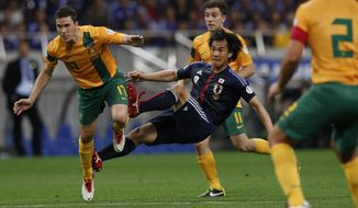 FILE - In this June 4, 2013, file photo, Japan's Shinji Okazaki, center, tries to score during their Asian zone Group B qualifying soccer match against Australia for the 2014 World Cup in Saitama, near Tokyo.  (AP Photo/Shuji Kajiyama, File) - SEE FURTHER WORLD CUP CONTENT AT APIMAGES.COM