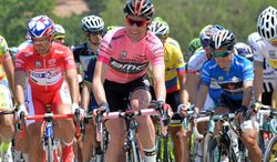 Overall leader Cadel Evans, center, pedals in the pack during the10th stage of the Giro d'Italia, Tour of Italy cycling race, from Modena to Salso Maggiore, Italy, Tuesday, May 20, 2014. (AP Photo/Gian Mattia D'Alberto)