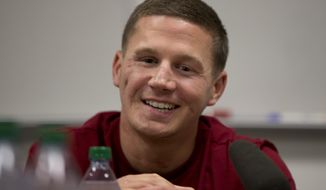 This photo taken May 13, 2014 shows Medically retired Marine Lance Cpl. Kyle Carpenter speaking to media at the Pentagon. The White House announced Monday that Carpenter, 24, will receive the medal of honor on June 19. He is the 15th recipient of the medal for service in Iraq and Afghanistan, the eighth still alive. (AP Photo/Carolyn Kaster)
