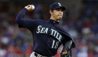 Seattle Mariners' Hisashi Iwakuma of Japan works against the Texas Rangers in the first inning of a baseball game, Tuesday, May 20, 2014, in Arlington, Texas. (AP Photo/Tony Gutierrez )