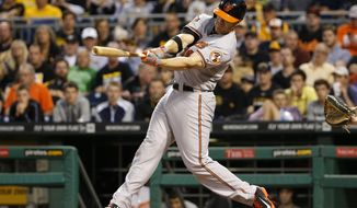 Baltimore Orioles' Chris Davis hits a two-run home run off Pittsburgh Pirates starting pitcher Francisco Liriano during the fifth inning of a baseball game in Pittsburgh on Tuesday, May 20, 2014. (AP Photo/Gene J. Puskar)