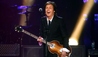FILE- In this June 8, 2013 file photo, Paul McCartney performs during a concert at the Barclays Center, in New York. McCartney is canceling his entire Japan tour. The former Beatle got a virus last week and canceled several appearances, apologizing online to his fans. Now, his organizers say he is not well enough to do any of the concerts in Japan, including the one set for Wednesday, May 21, 2014, at Nippon Budokan hall, where the Beatles performed during their first 1966 Japan tour. (Photo by Jason DeCrow/Invision/AP, File)