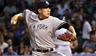 New York Yankees starting pitcher Masahiro Tanaka delivers during the first inning of an interleague  baseball game against the Chicago Cubs on Tuesday, May 20, 2014, in Chicago. (AP Photo/Charles Rex Arbogast)