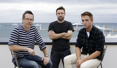 From left, actor Guy Pearce, director David Michod and actor Robert Patinson pose for a portrait to promote The Rover at the 67th international film festival, Cannes, southern France, Monday, May 19, 2014. (AP Photo/Thibault Camus)