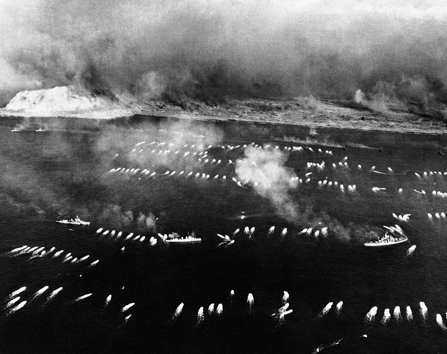 Marines head for the beach at the Japanese Island of Iwo Jima, Japan on Feb. 19, 1945, after the invasion started. Photo was taken by a Navy Photographer from a Navy search plane. (AP Photo/U.S. Navy)