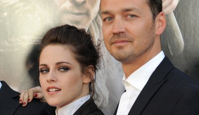KRISTEN STEWART-  Us Weekly published photos of Stewart having an affair with her Snow White and the Huntsman director, Rupert Sanders. (AP photo)