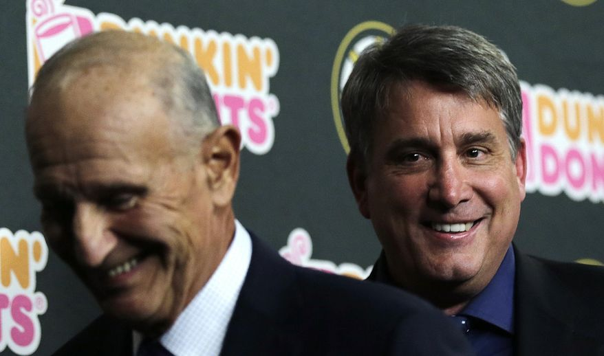 Boston Bruins president Cam Neely, right, smiles as leaves with team owner Jeremy Jacobs after a news conference in Boston, Tuesday, May 20, 2014. The Bruins were eliminated from the NHL hockey playoffs by the Montreal Canadiens. (AP Photo/Charles Krupa)