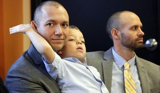 FILE - In this Jan. 21, 2014, file photo, plaintiffs Matthew Barraza, left, and his husband Tony Milner, right, look on as their son Jesse, 4, plays, during a news conference, in Salt Lake City. A federal judge on Monday, May 19, 2014, ordered Utah officials to recognize more than 1,000 same-sex marriages that took place in the state before the U.S. Supreme Court issued an emergency stay. If the rulings stands after a 21-day hold the judge placed on it, the state would be required to lift its freeze on benefits requested by gay couples. (AP Photo/Rick Bowmer, File)