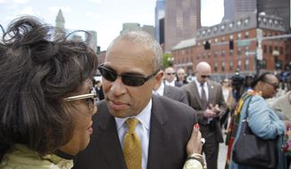 Massachusetts Gov. Deval Patrick leans in to kiss Beverly Morgan-Welch, executive director of the Museum of African-American History during a ceremony to honor Zipporah Potter Atkins, the first African-American to purchase property in Boston, near where her house stood Tuesday, May 20, 2014 in Boston. Atkins bought here house in 1670 in an area on the edge of what is today known as Boston's North End. (AP Photo/Stephan Savoia)