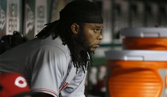 Cincinnati Reds starting pitcher Johnny Cueto sits in the dugout after being relieved during the sixth inning of a baseball game against the Washington Nationals at Nationals Park on Tuesday, May 20, 2014, in Washington. The Nationals won 9-4. (AP Photo/Alex Brandon)