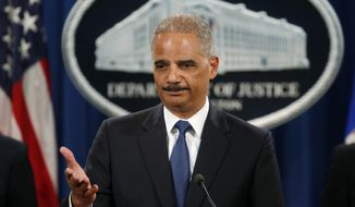 "FILE - This May 19, 2014 file photo shows Attorney General Eric Holder taking questions during a news conference at the Justice Department in Washington where he announced that a U.S. grand jury has charged five Chinese hackers with economic espionage and trade secret theft. In a 31-count indictment, the Justice Department said five Chinese military officials operating under hacker aliases such as ""Ugly Gorilla,"" ""KandyGoo"" and ""Jack Sun"" stole confidential business information, sensitive trade secrets and internal communications for competitive advantage. The U.S. identified the alleged victims as Alcoa World Alumina, Westinghouse, Allegheny Technologies, U.S. Steel, United Steelworkers Union and SolarWorld. China denied it all.  (AP Photo/Charles Dharapak, File)"