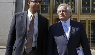Conservative scholar and filmmaker Dinesh D'Souza, left, accompanied by his lawyer Benjamin Brafman leave federal court, in New York,  Tuesday, May 20, 2014.  D'Souza has pleaded guilty in New York federal court to making illegal campaign contributions. He admitted getting two close associates to make $10,000 contributions to Wendy Long. She was a candidate who lost the New York Senate race in 2012 to the Democratic incumbent. His plea agreement calls for a sentence of 10 to 16 months in prison. He'll be sentenced on Sept. 23. (AP Photo/Richard Drew)