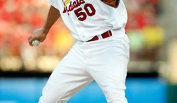 St. Louis Cardinals starting pitcher Adam Wainwright  throws during the first inning of a baseball game against the Arizona Diamondbacks Tuesday, May 20, 2014, in St. Louis. (AP Photo/Scott Kane)