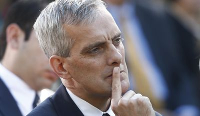 This Oct. 21, 2013, file photo shows White House Chief of Staff Denis McDonough listening to President Barack Obama speak in the Rose Garden of the White House in Washington. (AP Photo/Charles Dharapak, File)