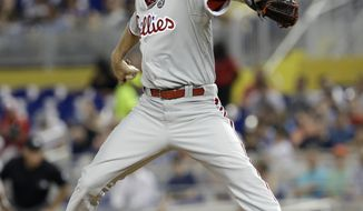 Philadelphia Phillies' A.J. Burnett pitches against the Miami Marlins in the first inning of a baseball game in Miami, Tuesday, May 20, 2014. (AP Photo/Alan Diaz)