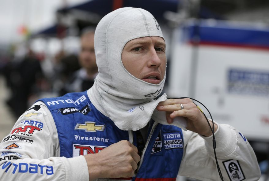 Ryan Briscoe, of Australia, puts on his racing suit before a practice session for the Indianapolis 500 IndyCar auto race at Indianapolis Motor Speedway in Indianapolis, Wednesday, May 14, 2014. (AP Photo/Darron Cummings)