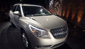 FILE - This April 3, 2012 file photo shows the 2013 Buick Enclave as it is unveiled at a news conference ahead of the New York International Car Show, in New York. General Motors on Tuesday, May 20, 2014 announced the recall of 2.4 million vehicles in the U.S., including the 2013 Enclave and other full-size crossovers from the 2009-2014 model years, as part of a broader effort to resolve outstanding safety issues more quickly. (AP Photo/Mary Altaffer, File)