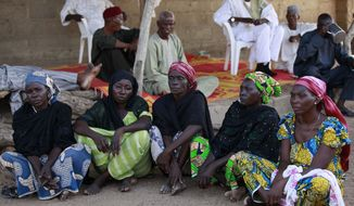 In this photo taken Sunday, May 18, 2014, some of the mothers of the kidnapped school girls sit in Chibok, Nigeria. More than 200 schoolgirls were kidnapped from a school in Chibok in Nigeria's north-eastern state of Borno on April 14. Boko Haram claimed responsibility for the act. (AP Photo/Sunday Alamba)