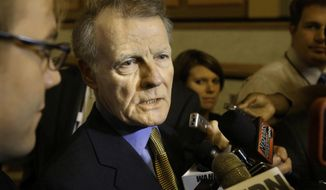 In this Wednesday, May 14, 2014 photo, Illinois Speaker of the House Michael Madigan, D-Chicago, is surround by reporters after exiting a House committee hearing at the Illinois State Capitol in Springfield, Ill. Madigan says he does not have the votes to extend Illinois's  income tax increase and is moving forward with a budget that does not rely on it. (AP Photo/Seth Perlman)