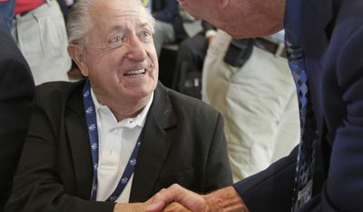 Rex White, left, is congratulated by Ned Jarrett, right, after being named as one of five inductees into the NASCAR Hall of Fame class of 2015 during an announcement in Charlotte, N.C., Wednesday, May 21, 2014. (AP Photo/Chuck Burton)