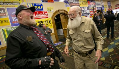 Walt Bayes (right), and Harley Brown (left), Republican candidates for Idaho Governor share a joke during an Idaho Republican Party Primary Night Celebration Tuesday May 20, 2014 held at The Riverside Hotel in Boise, Idaho. (AP Photo/The Idaho Statesman,Kyle Green)