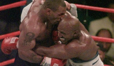 """Mike Tyson and Evander Holyfield, seen here in the 1997 match when Mr. Tyson bit off part of Mr. Holyfield's ear, will meet Friday on """"The Oprah Winfrey Show."""""""