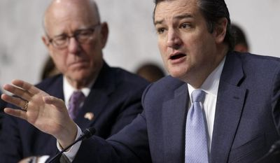 ** FILE ** Senate Rules Committee member Sen. Ted Cruz, R-Texas, right, joined by the committee's ranking member Sen. Pat Roberts, R-Kansas, speaks on Capitol Hill in Washington, Wednesday, April 30, 2014. (AP Photo)