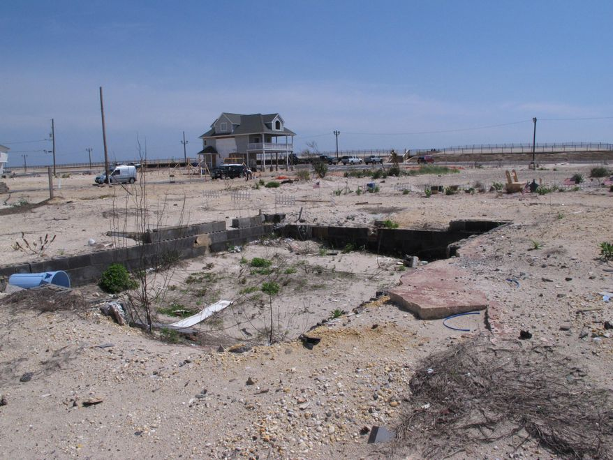 This May 12, 2014 photo shows vacant lots stretching to the oceanfront in the ortley beach section of Toms River N.J., where highly sought-after vacation and primary homes once sat before they were destroyed by Superstorm Sandy. As the second summer after the Oct. 29, 2012 storm arrives, some at the Jersey shore are getting their lives back together, while for others, getting back to normal is still a long way off.(AP Photo/Wayne Parry)