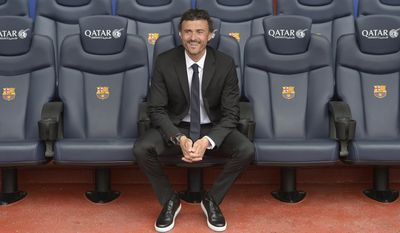 Luis Enrique smiles from the bench during his official presentation as new coach of FC Barcelona at the Camp Nou stadium in Barcelona, Spain, Wednesday, May 21, 2014. Luis Enrique looks on from the bench during his official presentation as new coach of FC Barcelona at the Camp Nou stadium in Barcelona, Spain, Wednesday, May 21, 2014. Former Barcelona player Luis Enrique signed a two-year contract to become coach on Wednesday, a hire the club hopes will resemble the success stories of Johan Cruyff and Pep Guardiola. (AP Photo/Manu Fernandez)
