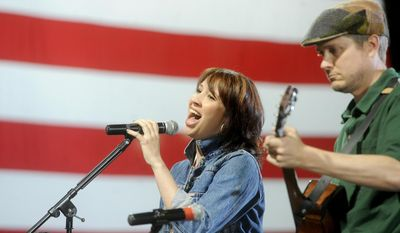 Emily Falvey sings to the crowd during a rally at Santander Stadium on Tuesday, May 20, 2014 after Tom Wolf won the Democratic nomination for Pa. (AP Photo/York Daily Record, Jason Plotkin)