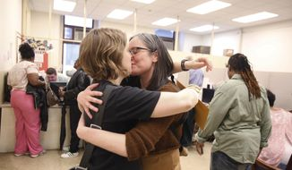 Emily Gavin and Eliza Callard kiss after getting their marriage license this morning at the Register of Wills at City Hall in Philadelphia on Wednesday, May 21, 2014.  Same-sex couples in Pennsylvania clamored for marriage licenses after a judge ruled to allow the state to join the rest of the Northeast in legalizing gay weddings, with Philadelphia offices staying open late to handle a rush of applications. Under state law, couples must wait three days after their application to get married unless a sympathetic judge grants a waiver.  (AP Photo/The Philadelphia Inquirer, Ed Hille)