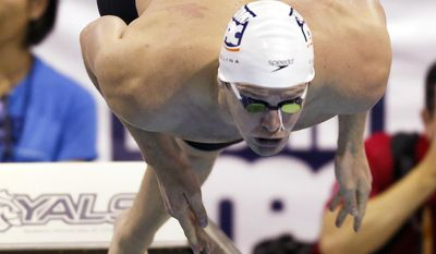 Tyler Clary dives in at the start of the 200-meter individual medley at the Grand Prix swim meet in Charlotte, N.C., Sunday, May 18, 2014. (AP Photo/Nell Redmond)