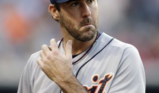 Detroit Tigers starting pitcher Justin Verlander walks back to the dugout during the second inning of a baseball game against the Cleveland Indians, Tuesday, May 20, 2014, in Cleveland. (AP Photo/Tony Dejak)