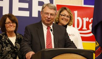 Idaho Secretary of State candidate Lawerence Denney, with his wife Donna on the left and daughter Jennifer on the right, gives a speech before all votes are counted but after he's comfortable with his lead during the Idaho GOP Primary election night event at the Riverside Hotel in Boise, Idaho, on Tuesday, May 20, 2014. (AP Photo/Otto Kitsinger)