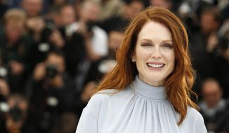 Actress Julianne Moore poses for photographers during a photo call for Maps to the Stars at the 67th international film festival, Cannes, southern France, Monday, May 19, 2014. (AP Photo/Alastair Grant)